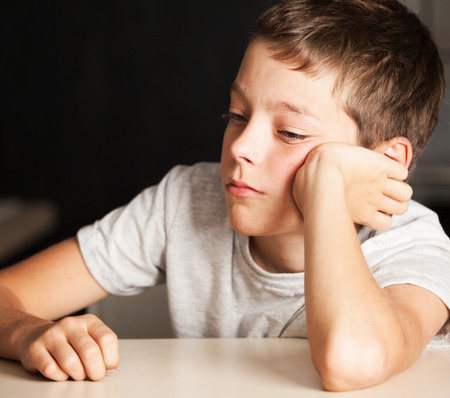 only one teenage boy: Sad boy at home. Unhappy child. Emotions stress at teenager Stock Photo