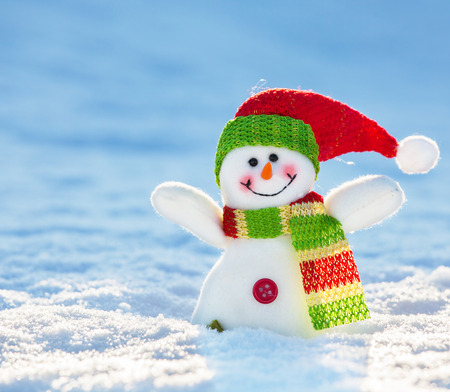 wintery day: Snowman on snow. Christmas decoration. Winter