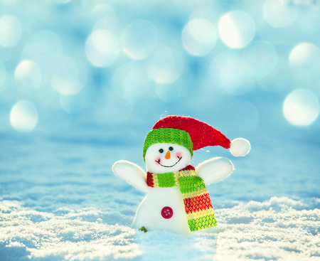 winter day: Snowman on snow. Christmas decoration. Winter