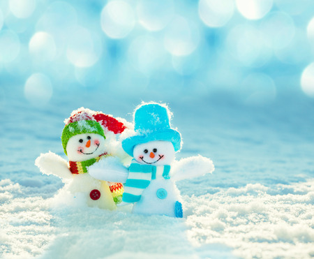 Snowman on snow. Christmas decoration. Winter photo