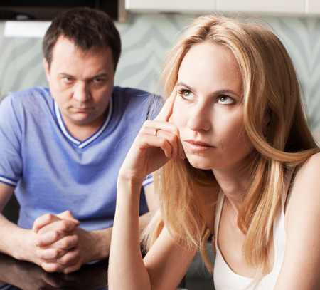 Conflict between man and woman at home. Couple divorce 스톡 콘텐츠