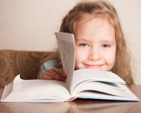 7 8 years: Girl with book. Child education