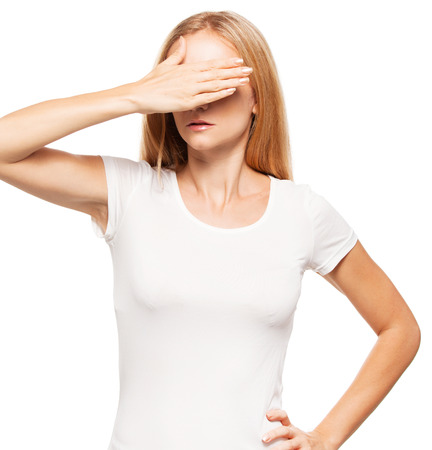 20 24 years: Woman at white background. Young female covering her face with her hands