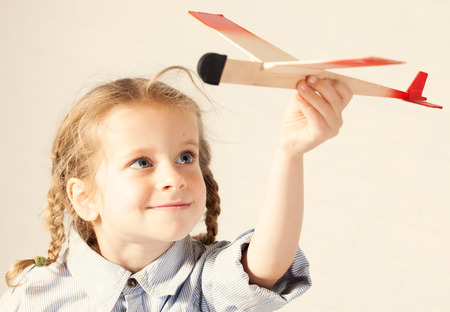 3 4 years: Child playing with toy. Girl with plane