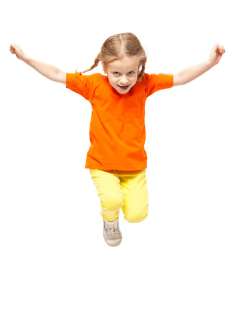 Jumping little child. Girl isolated on white photo