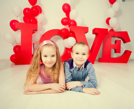 midair: Childrens  love. Decoration for celebration. Valentines, mothers day or weddings Stock Photo