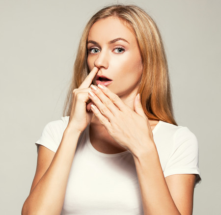 nose picking: Woman picks his nose finger. Female climbs a finger in nose. Embarrassment