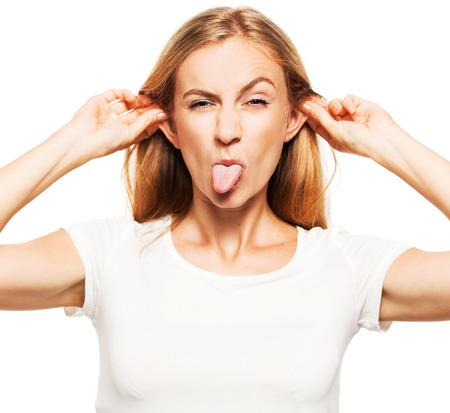 20 24 years: Woman stuck out her tongue. Hamming female on white Stock Photo