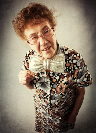 Merry old woman. Happy fun granny. Adult funny female on party photo