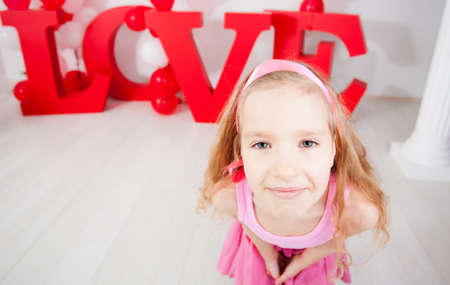 carved letters: Child in love. Decoration for celebration. Valentines, mothers day or weddings Stock Photo