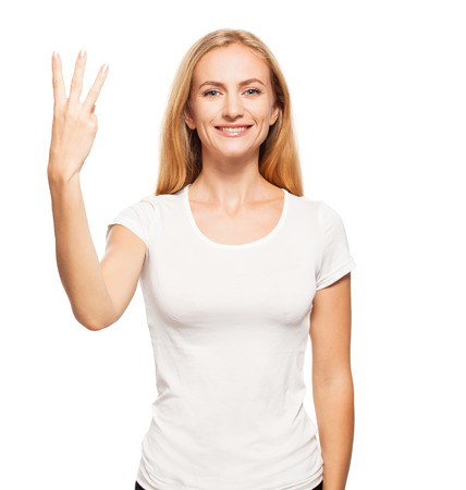 Woman at white background. Young female shows gesture photo