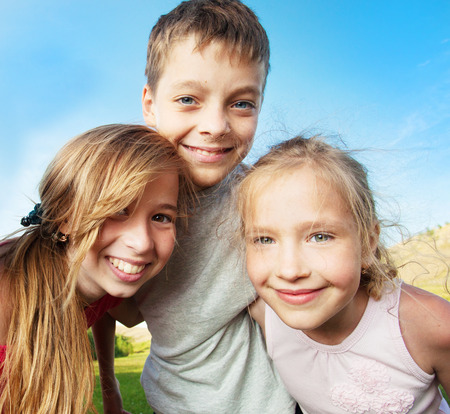 only girls: Happy children outdoors. Friends at summer