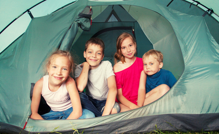 3 5 years: Children in a tent. Camping. Happy kids at summer vacations