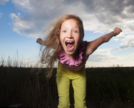elementary age girl: Happy girl at summer. Crazy child