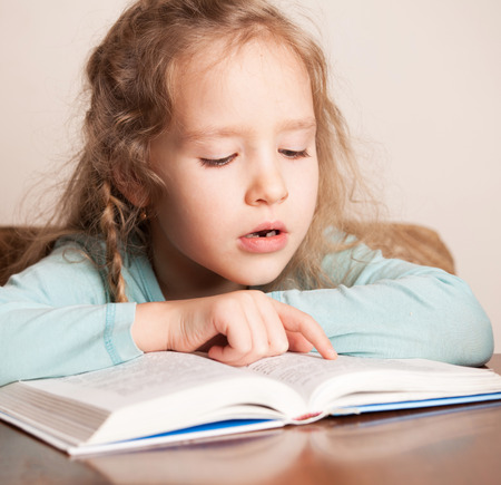 Girl reading book. Child education Stock Photo