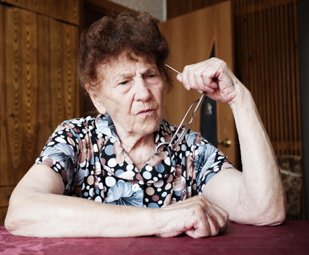 80 plus years: Old woman. Thinking elderly female at home Stock Photo