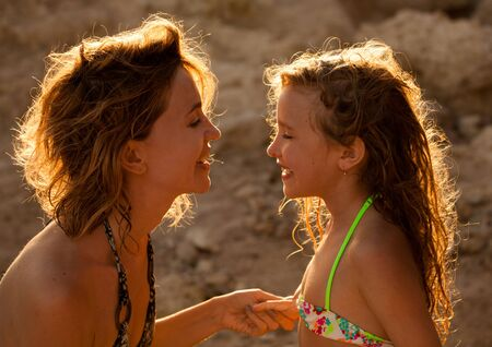 mom: Loving moments of mother and child. Mom and girl on sunset Stock Photo