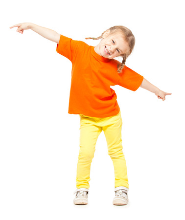 Little girl at yellow jeans. Child on white background Foto de archivo