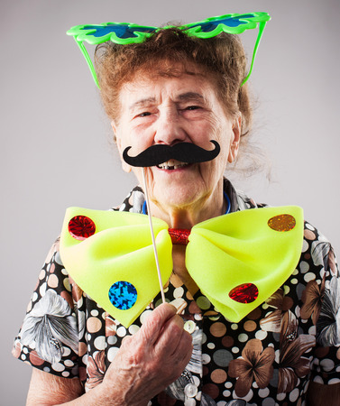 mature women only: Merry old woman. Happy fun granny. Adult funny female on party