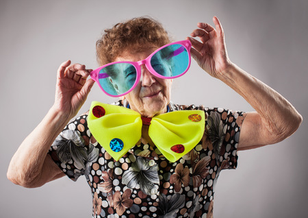 80 plus adult: Merry old woman. Happy fun granny. Adult funny female on party