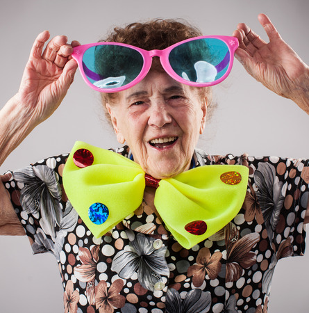 80 plus years: Merry old woman. Happy fun granny. Adult funny female on party