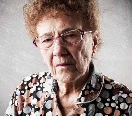 80 plus years: Portrait  old woman. Sad adult female. Grandmother