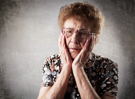 80 year old: Portrait  old woman. Sad adult female. Grandmother