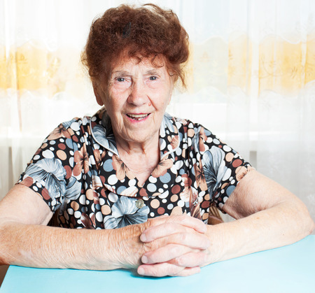 80 plus years: Old woman. Elderly smiling female at home