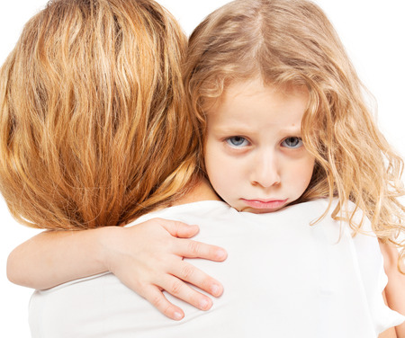 two girls hugging: Sad child embracing mother. Girl with female.