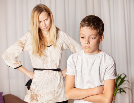conflict: Mom swears by son. Conflict, problems in family. Sad mother and child Stock Photo