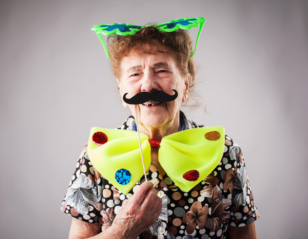 Merry old woman. Happy fun granny. Adult funny female on party