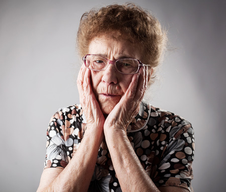 Portrait  old woman. Sad adult female. Grandmother photo