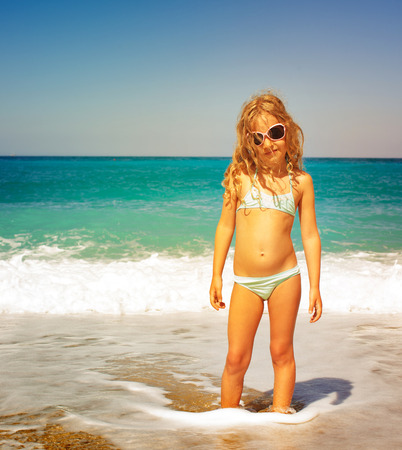 only 1 girl: Child on the beach. Girl at vacations on sea