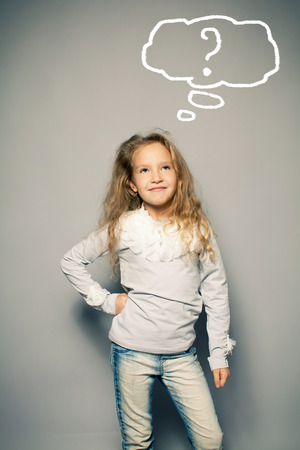 only girls: Thinking child. Portrait girl looking up Stock Photo