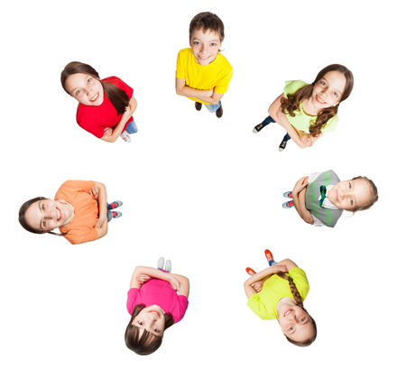 view girl: Happy group children isolated at white background. Smiling teen. Frendship boys and girls