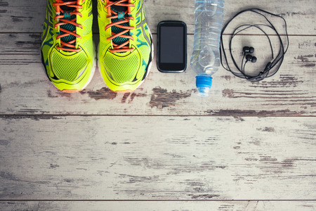 water shoes: Accessories for sports, lying on the floor in a fitness club Stock Photo