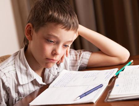crying boy: Sad boy doing homework. Child education