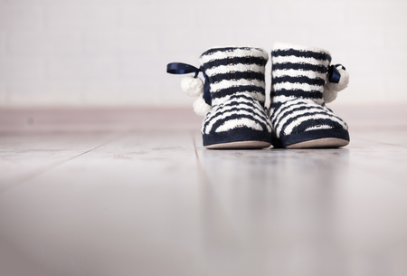 wood flooring: Warm slippers on the background old white floor. Homeliness. Stock Photo