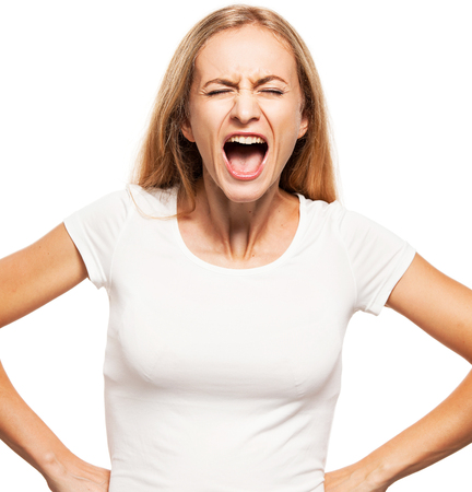 on a white background: Screaming woman isolated on white bacjground. Emotional stress, problems, frustration, hysterical, desperation