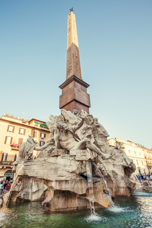 navona: ROME, ITALY - JULY 9: Tourists visiting the famous Piazza Navona, fountain Four Rivers, July 9, 2015.