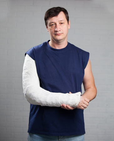 human arm: Man with a plaster. Broken arm, shoulder. Injury