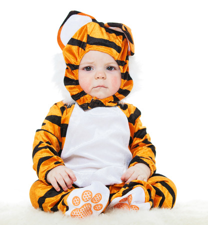 males only: Baby dressed as a tiger. masquerade