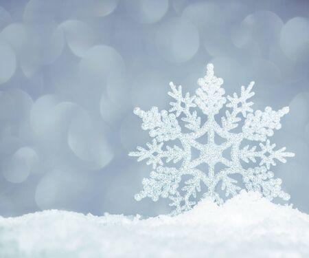 snowflake snow: Snowflake on snow. Studio shot. Christmas Stock Photo
