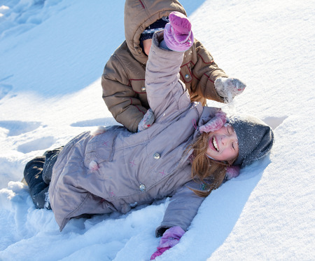 one person only: Children in the snow in winter. Stock Photo