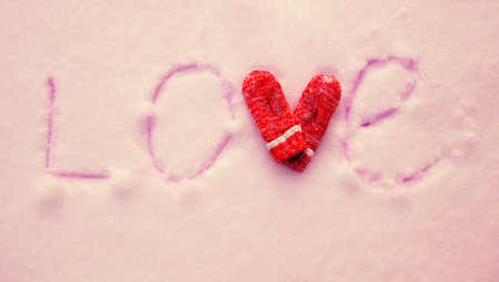 winter fashion: Inscription on the snow love. Valentines, day. Winter Stock Photo