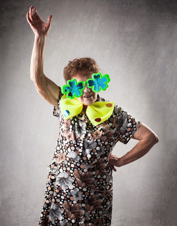80 90: Merry old woman. Happy fun granny. Adult funny dancing female on party