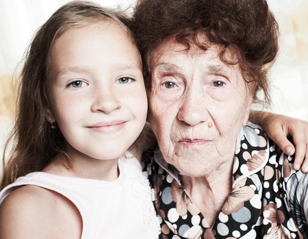 80 year old: Senior with girl. Generation. Elderly woman with great-grandchild Stock Photo