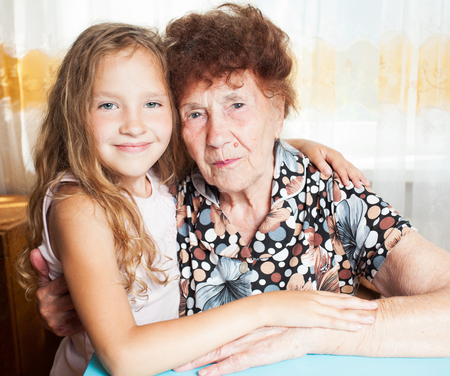 80 plus years: Senior with girl. Generation. Elderly woman with great-grandchild Stock Photo