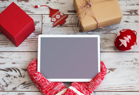 Tablet on Christmas background. New Year holiday