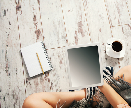 freelancer: Woman with tablet,  cup of coffee, notepad at home. Freelancer Stock Photo